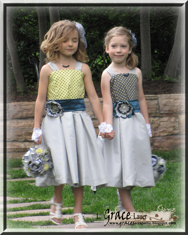 Flower girls walking with hand made flower poms and hair pieces