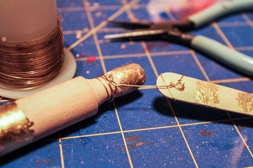 Jvanderbeek_helmar_gildedgarland_stringing_wire_wrapping_spoons_rolling_pins