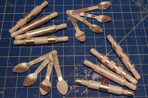 Jvanderbeek_helmar_gildedgarland_leafed_gilded_wooden_spoons_rolling_pins_miniatures