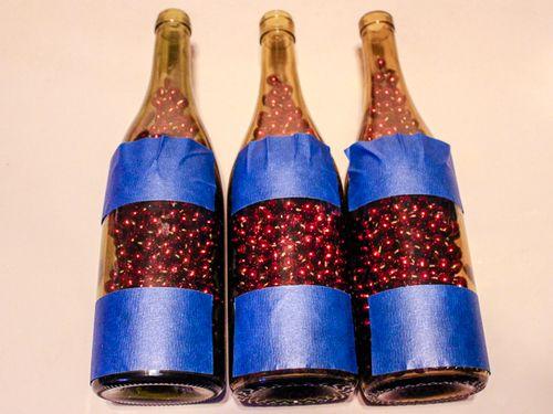 Jvanderbeek_helmar_holiday_bottleart_taping_preparatin