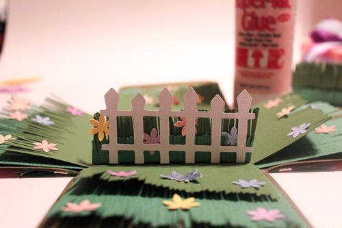 Jvanderbeek_helmar_easterbox_picket_fence_paper_grass_flowers_border